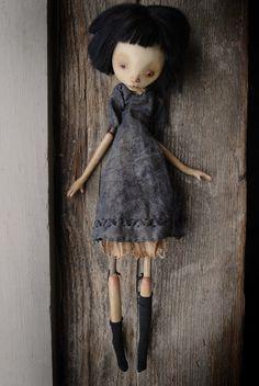 Dounia    12.5 inches; stone clay, wood, english viscose fiber, textiles; 2011