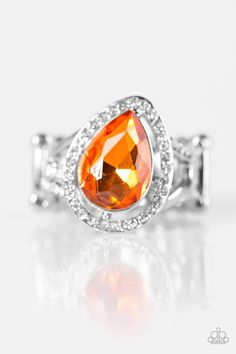 A silver teardrop frame is encrusted with glittery white rhinestones. Featuring a faceted surface, an orange gem sits atop the teardrop frame, creating a regal pop of sparkle. Sold as one individual ring.