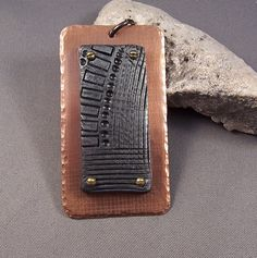 This listing is for the polymer clay industrial piece mounted on an etched copper rectangle. It measures 58mm x 32mm and includes a copper jump
