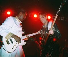 Former Sly and the Family Stone bassist Larry Graham, left, shares the stage with Prince -- who then was known as The Artist Formerly Known as Prince -- during a surprise appearance at a nightclub on Friday, April 10, 1998, in Manhattan.