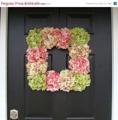 Glue flowers on an inexpensive picture frame to make a wreath.- We could do two wreaths with white hydreas and white orange bow to hang and have a baby pic of you and jordan in each