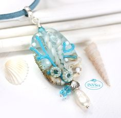 Water blue beaded pendant with white pearl, Beach jewelry, One of a kind handmade lampwork glass necklace Beach Jewellery, Jewelry, Pearl Beach, Water Blue, Sea Glass Necklace, Lampwork Beads, Sterling Silver Chains, Pearl White, Glass Beads