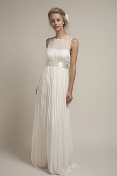 Round high neck chiffon gown with illusion lining neckline which gives elegant yet sexy neckline. Floor length, comes with silk charmeuse sash.