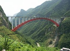 """Zhijinghe River Bridge - Dazhipingzhen, Hubei, China; 965 feet high, with a 1,411 feet long span; opened in 2009; currently the highest arched roadway bridge; """"one of many jaw-dropping high bridges along the Yichang-Enshi portion of the 1,350 mile long West Hurong highway connecting Shanghai with Chongqing and Chengdu; from HighestBridges.com"""