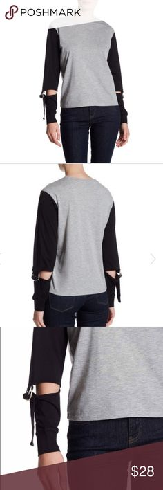 "TOPSHOP Raglan Top with Reattached Sleeves Topshop Raglan top with reattached sleeves in grey and black. Gorgeous and perfect for the fall! Brand new without tags (never worn)  56% Polyester, 44% Cotton  Length: 23"" Chest: 20.5"" when laid flat Topshop Tops Tees - Long Sleeve"