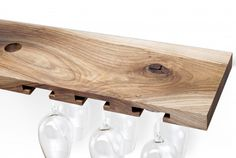 Simple wooden wine rack. Made of one piece of walnut wood. It contains four bottles and six glasses.  for polish orders: www.tulas.pl  for international orders: https://www.etsy.com/listing/244065592/wooden-wine-rack-model-b-walnut?ref=listing-shop-header-2