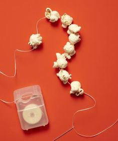 Dental Floss as DIY Popcorn Garland    String a popcorn garland for the holidays (after a pit-stop in the medicine cabinet).