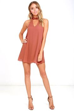 Show 'em how to shake it in the Groove Thing Rusty Rose Swing Dress! A mock neck and front cutout top this flirty swing dress composed of lightweight woven poly. Back keyhole with two top clasp closures.