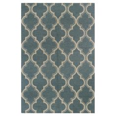 The perfect complement to eclectic decor and worn leather sofas, this hand-tufted wool rug features a striking quatrefoil design. Pair with cushions and acce...