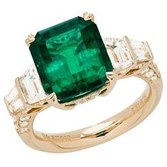 Guess How Much This Costs. Its a Colombian Emerald and Diamond Ring in 18kt yellow gold