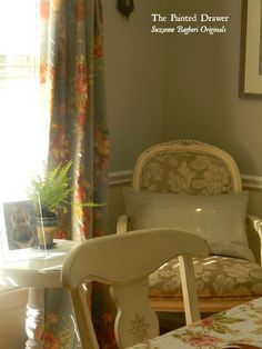 Love the corner chair AND the drapery material.