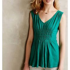 "Anthropologie Deletta Center Smocked Green Tank New with tags, lovely basic top by Deletta for Anthro. Center cinching stitches give this easy cotton tee a flattering twist. 100% cotton. 25.5"" long. Bust approx. 17."" Beautiful emerald green color. Anthropologie Tops Tank Tops"