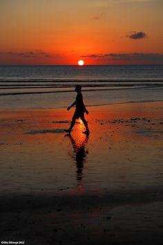 Walking silhouette at Kuta Beach, Bali