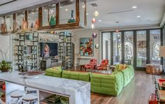 His home includes a golf-simulator room, an indoor basketball court, and a 12-car underground garage that (appropriately) has mural of the Augusta National clubhouse on the wall.Click through for more pictures of Jordan Spieth's home.