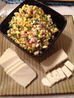 Charred and Raw Corn with Chile and Cheese Recipe - Bon Appétit (4 ears of corn, shallot, red chiles, lime juice, vegetable oil, cotija or queso fresco, cilantro, s&p)