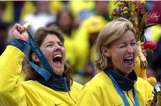 2000 Sydney Olympics... Natalie Cook and Kerri-Ann Pottharst of Australia thrilled on the podium during medal presentation celebrate after they won gold in the Women's Final of the Beach Volleyball of Sydney Olympic Games at Bondi Beach