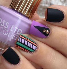 Love matte colors> this winter nail art is perfect for you. Complete with tribal designs and embellishments, this nail art design will surely rock your nails.