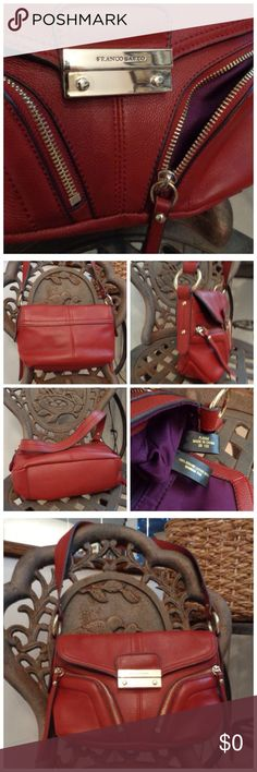 """FabuLous Red Leather Shoulder/Hand Bag Like New Made by: Franco Sarto Red Leather Shoulder/Hand Bag w/Gold Trim. Bag has two Front outside pockets w/Zippers and Leather Pulls, Inside has Four Phone Pockets and One Pocket w/Zipper, Fully Lined in Royal Purple, this purse has Magnetic Front Closure. Measurements: 7""""TallX 11""""WideX 3""""Thick. Like New/Showing No Wear. Beautiful Bag! Please see my other items and shop with confidence. Thank you for browsing my closet. Franco Sarto Bags"""