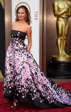 Christine Teigen arrives at the 86th Annual Academy Awards at the Dolby Theatre in Hollywood on March 2, 2014. (Jordan Strauss/Invision/AP)