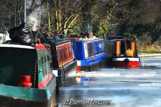 Narrow boats on frozen Grand Union Canal . New Bradwell , Milton Keynes .
