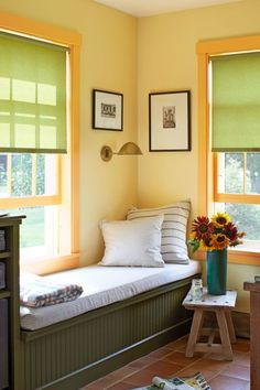 The sap bucket next to this built-in daybed in this New Hampshire home holds three types of sunflowers, including a pale-yellow variety that the owner bred himself, named Reggie's Mix. The beadboard is painted in Benjamin Moore's Guacamole.