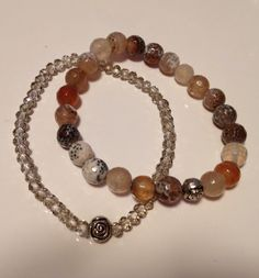 Bracelets made of agate, silver coat charms and cristals jade.