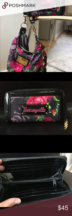 Betseyville Skull Roses Purse + Matching Wallet Gorgeous purse and wallet by Betseyville covered in purple skulls and bright pink roses and adorned with gold colored trim! Super fun for year round or to break out for Halloween! Betsey Johnson Bags