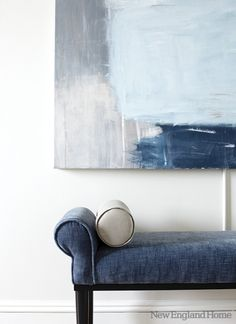 Decorating with denim...I love the colours of the simple art work behind!