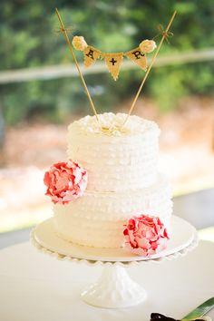 Ruffled Cake with Initial DIY Cake Topper - See the wedding here: http://www.StyleMePretty.com/australia-weddings/2014/05/19/diy-maleny-wedding-at-vue-de-lumieres/ Photography: Sunlit Studios - sunlitstudios.com.au - Cake: SunnyGirlCakes.blogspot.com.au