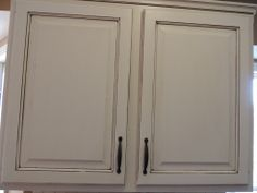 Repainted cabinet white topped with a medium-level glaze finish. Refinishing Cabinets, Cabinet Styles, Cabinet Finishes, Kitchen Cabinets, Cabinet, Inset Cabinets, Refinish Kitchen Cabinets, Kitchen, Kitchen Transformation