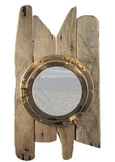 A brass porthole mounted on four driftwood planks with ragged ends worn smooth by the sea.The porthole glass is mirrored and is ideal for shaving. Each cabinet will be made to order and will be of the same design but will vary in the nature of the. Pirate Bathroom, Nautical Bathrooms, Bathroom Kids, Porthole Mirror, Wall Mirror, Mirrors, Pirate Decor, Pirate Theme, Deco Marine