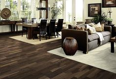 classic dark wood flooring w/dark furniture and white rugs {this room needs some COLOR}