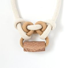 Wear something modern and unique with our knotted rope and Rewarewa necklace. This elegant necklace is a statement piece for any outfit. Made from hand-dyed cotton and linen rope and paired with a wooden Rewarewa bead and magnetic clasp. Rewarewa—also called New Zealand Honeysuckle—has an attractive speckled appearance and is a hard wearing wood.  Because these necklaces are hand-dyed in small batches numbers are limited. Please select your chosen colour at checkout. – tea – coral – green…