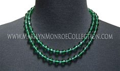 """Marilyn Monroe's Personal Beaded Necklace. A simple yet stunningly beautiful necklace owned by Marilyn Monroe, consisting of emerald toned beads, measuring 36"""" in length with a gold toned clasp. This necklace sold in 1999 at the now famous Christie's sale, """"The Personal Property of Marilyn Monroe."""""""
