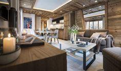 Intérieur chalet montagne haut de gamme, décoration bois luxe.