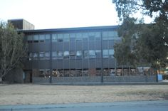 this might have been the school or an office building. some of the windows are boarded up and the others are smashed.