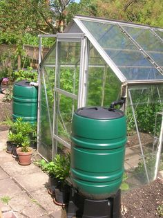 water butts I've finally gotten a greenhouse I just need to set up some water collecting barrels similar to this.I've finally gotten a greenhouse I just need to set up some water collecting barrels similar to this. Diy Greenhouse Plans, Backyard Greenhouse, Greenhouse Growing, Backyard Landscaping, Greenhouse Shelves, Simple Greenhouse, Dome Greenhouse, Greenhouse Farming, Underground Greenhouse