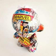 Customise your own vinyl toy Christmas decoration with vintage superhero comics. Step by step instructions.