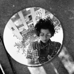 Vivian Maier self portrait 1953. Check out her other works too...Someone just found her undeveloped film at an auction. She was a very secretive nanny whose photography became famous years after her death.