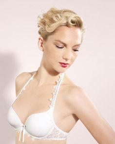 "This back- and shoulder-baring bra has a plunging neckline yet offers plenty of support; subtle adornment makes it pretty enough to wear on your wedding night. Marie Jo ""Dorothy"" halter bra, myintimacy.com for stores."