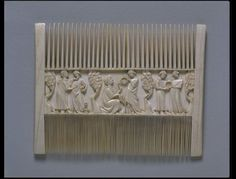 Comb depicting lovers in a garden, ivory, 1425-50, Paris, France.