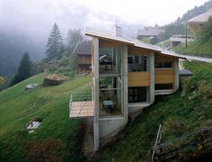 This house is located on the steep slopes of Austria 4,365 feet above sea level. The large windows allow for an amazing view of the untouched valley below. All of the materials used in building this great home were untreated: concrete, wood, glade, and metal.