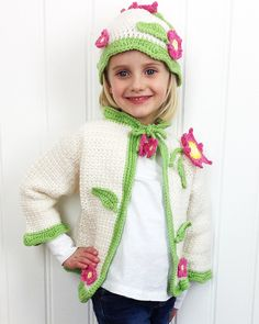 Design By: Marie Murray and Rosemarie Fagan Skill Level:Easy Size:Sweater to fit age 4 (6, 8) years Hat fits most ages. Materials: Worsted Weight Yarn: White or Purple (MC) - 12/16/20 oz Green (CC) -