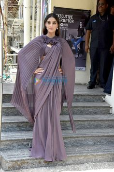 Sonam Kapoor at 'Sanju' Trailer Launch : Sonam looked absolutely stunning in this ultra sexy Gaurav Gupta saree with cape-like sleeves. Amrapali jewelry and simple hair-makeup completed her look. Very sultry! Fancy Blouse Designs, Stylish Dress Designs, Saree Blouse Designs, Stylish Sarees, Stylish Dresses, Fashion Dresses, Saree Draping Styles, Saree Styles, Drape Sarees