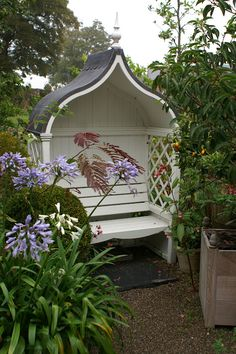 Beautiful covered garden bench - you can get similar designs with storage (for cushion pads etc) beneath the seat.