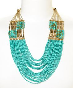 Gold & Turquoise Multi-Strand Bead Necklace. Not a big fan of the gold and turquoise together but this I do like.