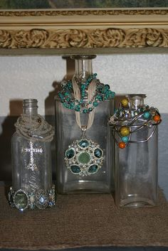 jewelry display ---what a neat way to display chunky bracelets, and necklaces!  Looks cool on vintage odd shaped bottles.