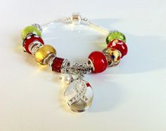 Red Green Xmas European Large Bead by ClearWaterDesignsbyK on  Etsy clearwaterdesignsbyk.etsy.com clearwaterdesigns.info Keep someone you love close this Xmas! This European Large Bead bracelet features a Breat Cancer Locket suitable for holding a photo or saying. Gorgeous High End Red, Green & Yellow European Lampwork & Silver Foil Beads are quality Morano Glass. The bracelet is Snake Chain Sterling Silver Stamped 925 on the easy snap on clasp. I