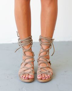 """Our Hera Gladiator Sandals are unforgettable! A peep toe, vegan suede, gladiator style sandal that knots and crosses around the leg. Lace them up to your knees or wear them casually at your ankles. 5"""""""