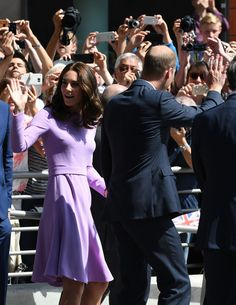 Prince William, Duke of Cambridge and Catherine, Duchess of Cambridge wave as they arrive to visit the Elbphilharmonie concert hall in Hamburg, northern Germany, on July 21,2017.